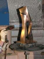 putting a brown patina on a bronze titled Dance